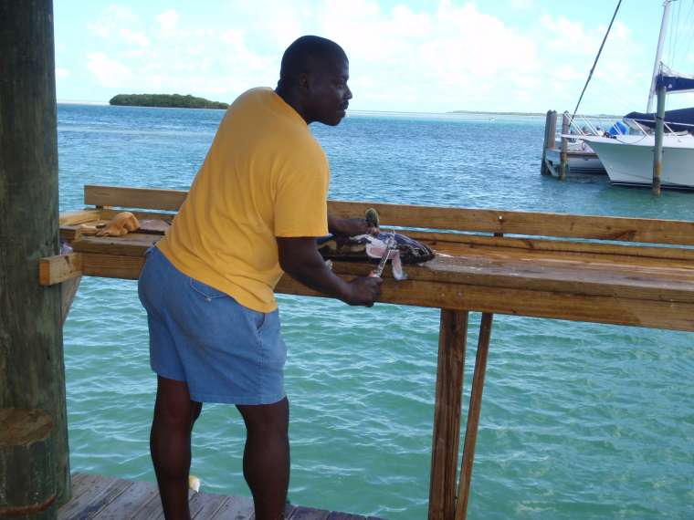 A local Bahamian cleaning fish in the marina