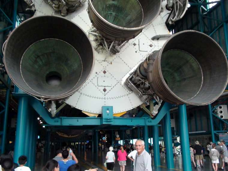 Lance dwarfed by the Saturn rocket